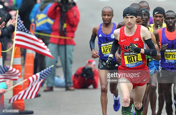 The pack with American Dathan Ritzenhein heads toward Mile 20 during the 119th Boston Marathon on Monday April 20 2015
