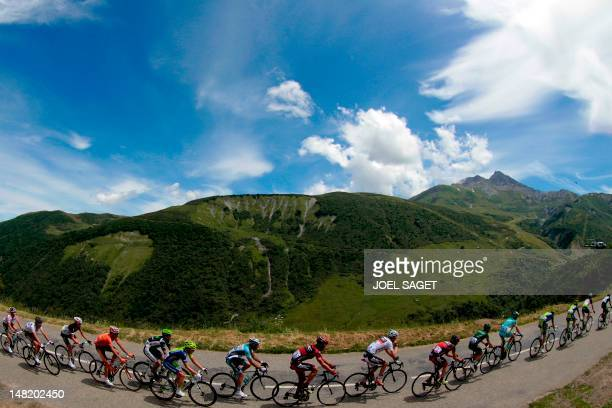 The pack, with Best climber's polka dot jersey, France's Thomas Voeckler , rides in the 148 km and eleventh stage of the 2012 Tour de France cycling...