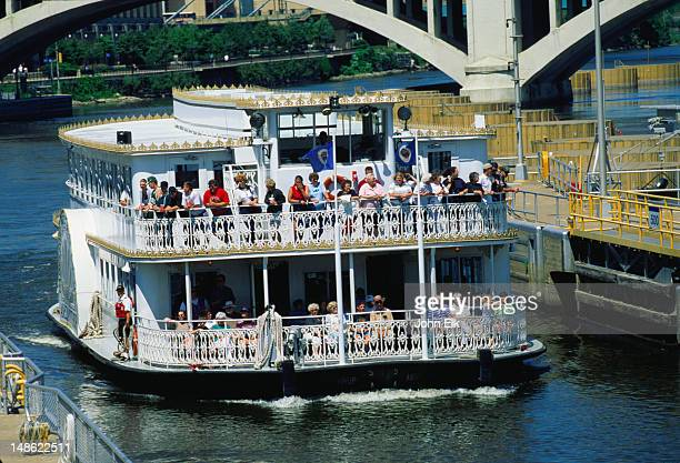 The paddle steamer makes its way through the Upper Lock - ST Anthonys Falls - Minneapolis-St Paul, Minnesota