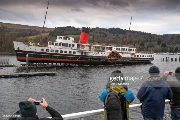 The paddle steamer the Maid of the Loch slips back into the water after the supporting cradle snapped on January 10 2019 in BallochScotland Loch...