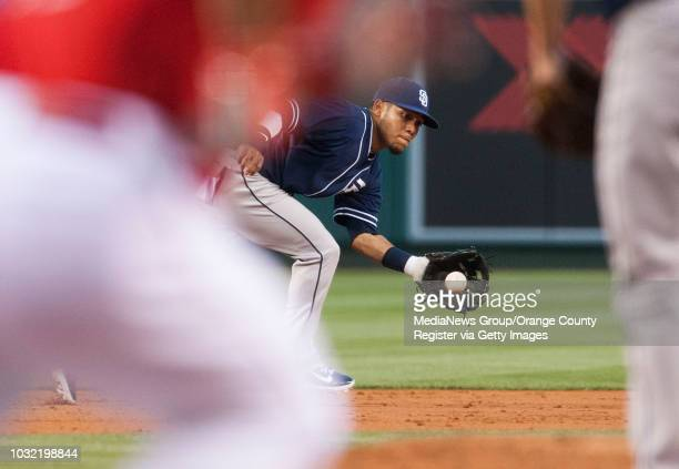 The Padres' Alexi Amarista snags a hit by the Angels' Chris Iannetta to start a double play in the second inning Wednesday night at Angel Stadium...