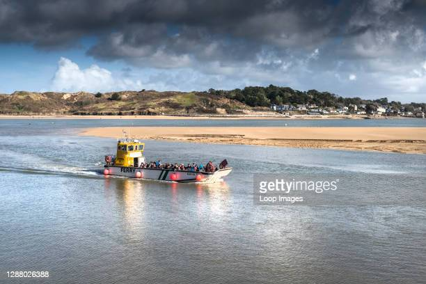 The Padstow to Rock Ferry steaming across the River Camel in North Cornwall.