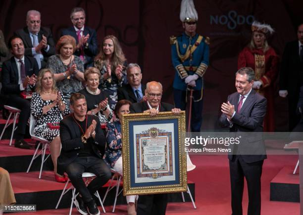 The paediatrician Ignacio Gomez, named Son of Seville, poses during the act of delivery of the titles of Favorite Son and Medals of the City, in the...