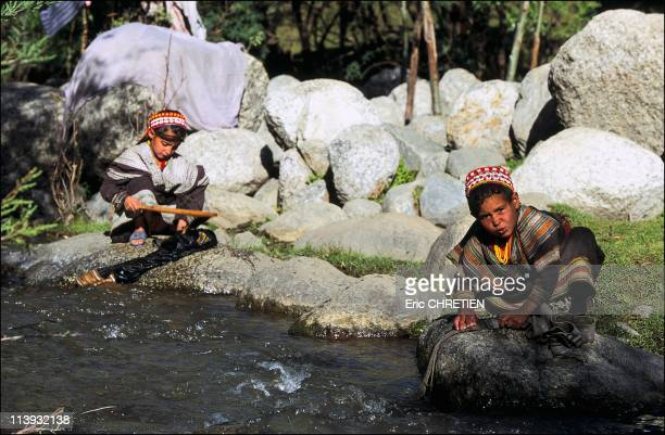 The pagan Kalash minority of Pakistan In Pakistan In July 2001Young girls washing in the stream the unique dress worn by all Kalash women a long...