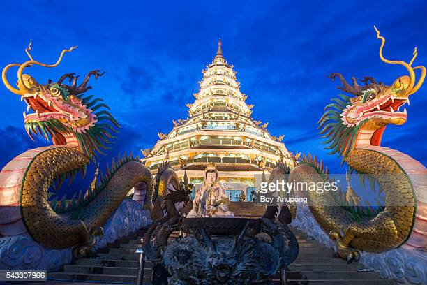 The pagoda in Chinese style with dragon guard in Chiangrai.