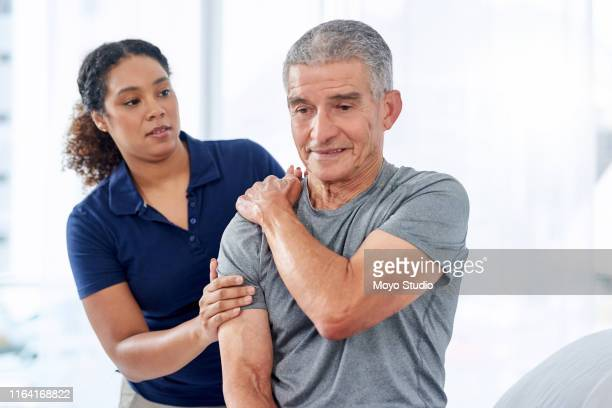 the pain is right on this spot doc - shoulder stock pictures, royalty-free photos & images