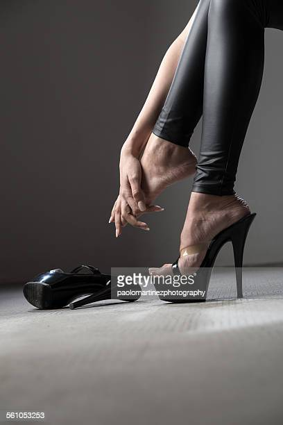 the pain of killer heels - black trousers stock photos and pictures