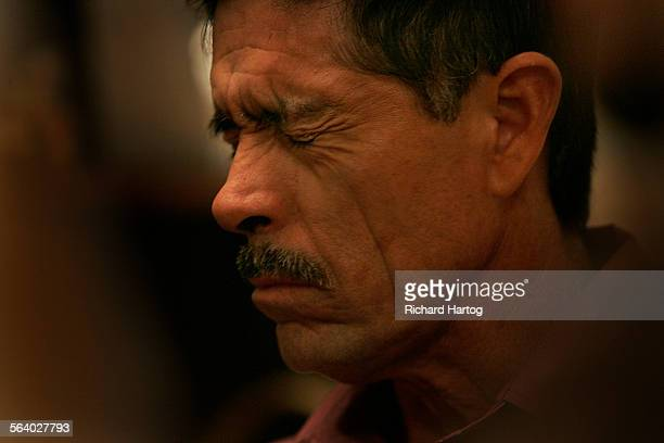The pain on the his face is evident as Camilo Zamundio squeezes to fight back tearsduring a memorial service for his brother Salud Zamudio Rodriguez...