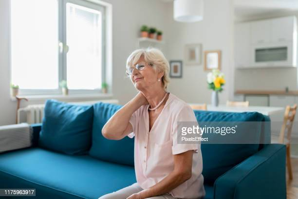 the pains that come with old age... - rheumatism stock pictures, royalty-free photos & images
