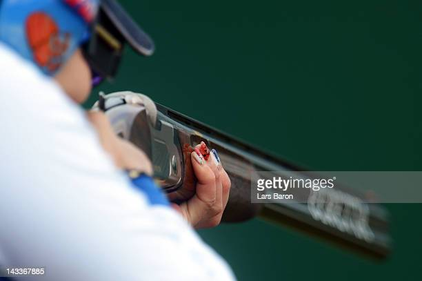 The painted fingernails from Yukie Nakayama of Japan are seen during the Women's Trap Qualification on day seven of the ISSF Shooting World Cup LOCOG...