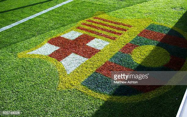 The painted logo of the badge / logo of FC Barcelona on the pitch at The Nou Camp Stadium home of FC Barcelona