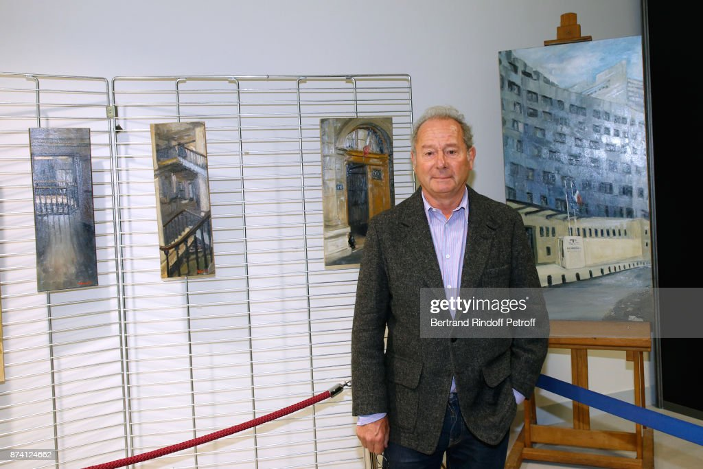 The Painter of the Navy Jacques Rohaut poses in front of his works during Sylvain Forge wins the '71eme Prix du Quai des Orfevres - 2018' for his Book 'Tension Extreme'. Held for the first time at new local of the 'Direction Regionale de la Police Judiciaire', 36 Rue du Bastion in Paris, France on November 14, 2017.