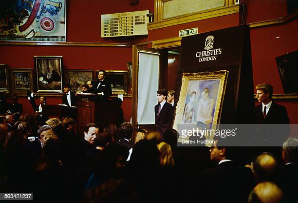 The painting 'Acrobate et Jeune Arlequin' by Pablo Picasso is sold at Christie's auction house in London for 209 million pounds 28th November 1988 It...