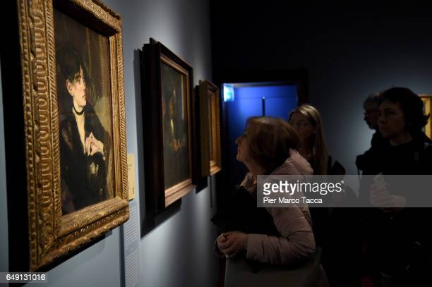 The painting 'Berthe Morisot with fa' by Edouard Manet is displayed during the Exhibition 'Manet E La Parigi Moderna' at Palazzo Reale on March 7...