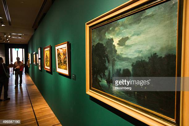 The painting 'Port Scene' by artist Mori Kinsen right hangs at the National Gallery Singapore in Singapore on Friday Nov 27 2015 The new visual arts...