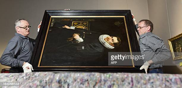 The painting Portrait of Jan Vermoelen by Peter Paul Rubens is lifted by museum employees on March 19 2013 at the Frans Hals Museum in Haarlem In...
