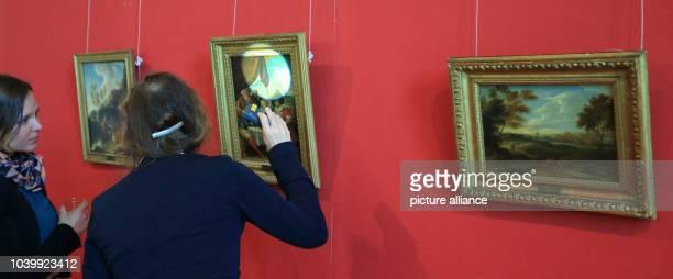 The paintings 'Baumbestandene Felsenlandschaft' 'Der verlorene Sohn' and 'Landschaft mit Staffage' that were returned by the US foundation Monuments...