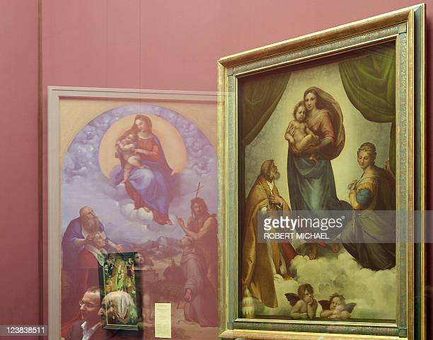 The paintings 'Sixtinische Madonna' and the 'Madonna di Foligno' wich are closely related by Italian artist Raphael are displayed at the...