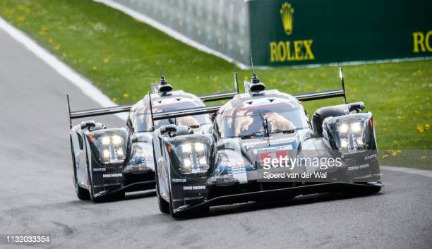 The pair of Porsche 919 Hybrid sportsprototype racing cars with the car driven by Timo Bernhard Mark Webber and Brendon Hartley leading the car...