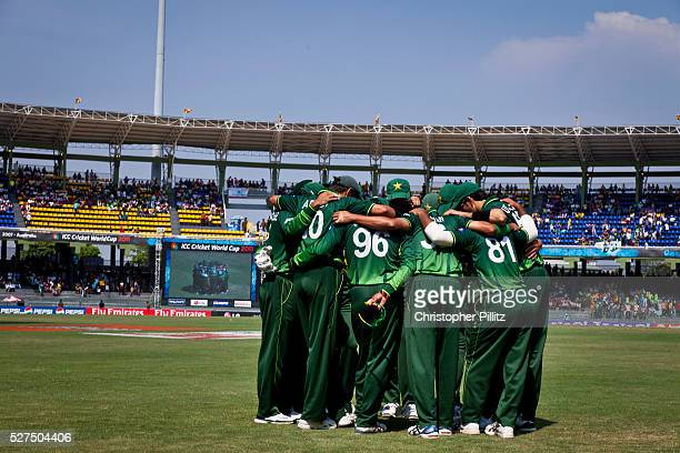 The Pakistan 2011 World Cup Cricket squad create a huck on the pitch as they await the arrival of the Australian team in their group stage match...