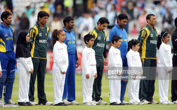 The Pakistan and Sri Lanka teams line up together to remember the terrorist attacks in Lahore before the ICC World Twenty20 Super Eights match at...
