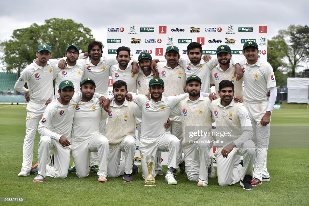 The Pakistan cricket team pose with the match trophy after defeating Ireland on the fifth day of the international test cricket match between Ireland and Pakistan on May 15, 2018 in Malahide, Ireland.