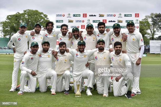 The Pakistan cricket team pose with the match trophy after defeating Ireland on the fifth day of the international test cricket match between Ireland...