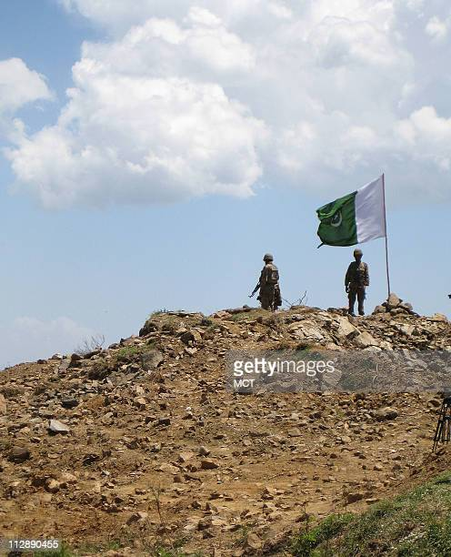 The Pakistan flag flies on May 22 at Baine Baba Ziarat a hill top recently captured from the Taliban near Khwazakhela Valley