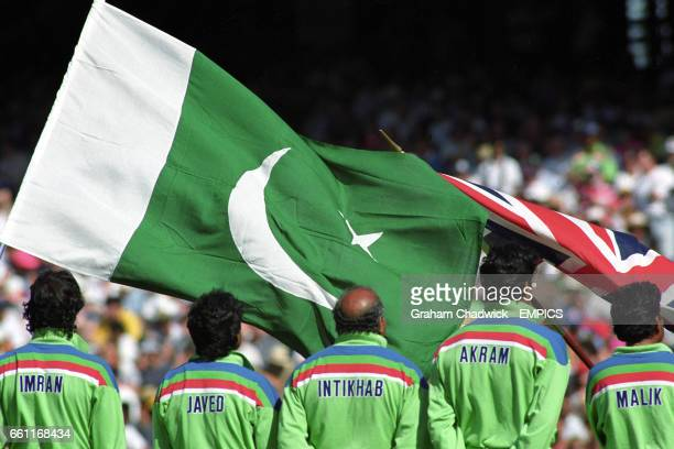 The Pakistan players line up in front of their national flag before the match