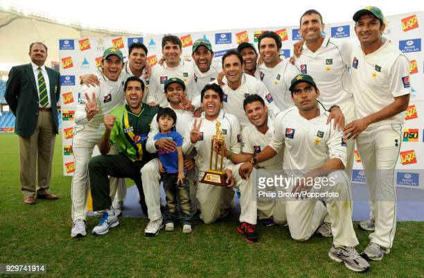 The Pakistan team celebrate with the series trophy after winning the 3rd Test match between Pakistan and England by 71 runs and sweeping the series...