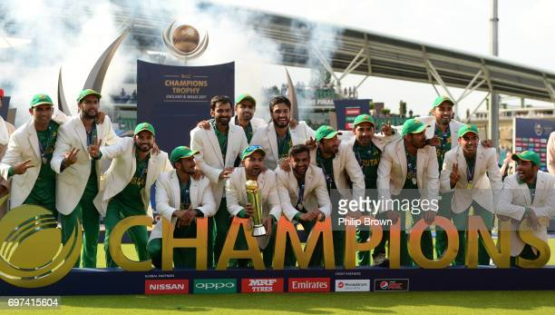 The Pakistan team celebrate with the trophy after winning the ICC Champions Trophy final match between India and Pakistan at the Kia Oval cricket...