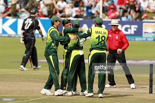 The Pakistan team celebrates the wicket of Shane Bond during the Twenty20 Cup Semi Final match between New Zealand and Pakistan at Newlands Cricket...