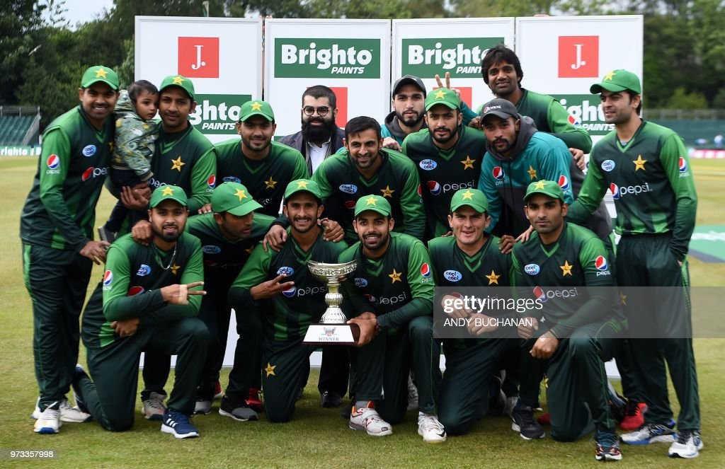The Pakistan team pose for a photograph with the trohy after winning both of their Twenty20 International cricket matches against Scotland, on the secongd day at the Grange Cricket Club in Edinburgh, Scotland, on June 13, 2018.