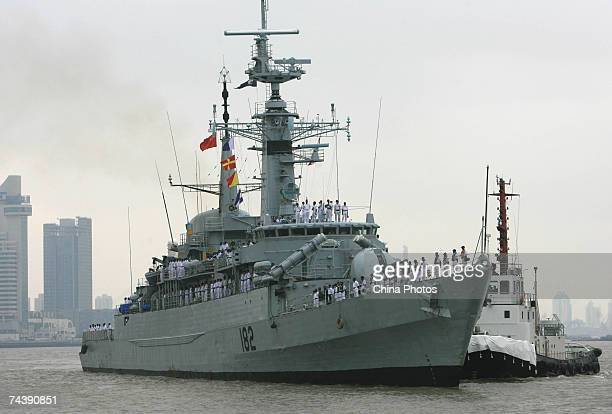 The Pakistani destroyer Babur and a depot ship sail on the Huangpu River on arrival June 4 2007 in Shanghai China Babur is in China for a fourday...