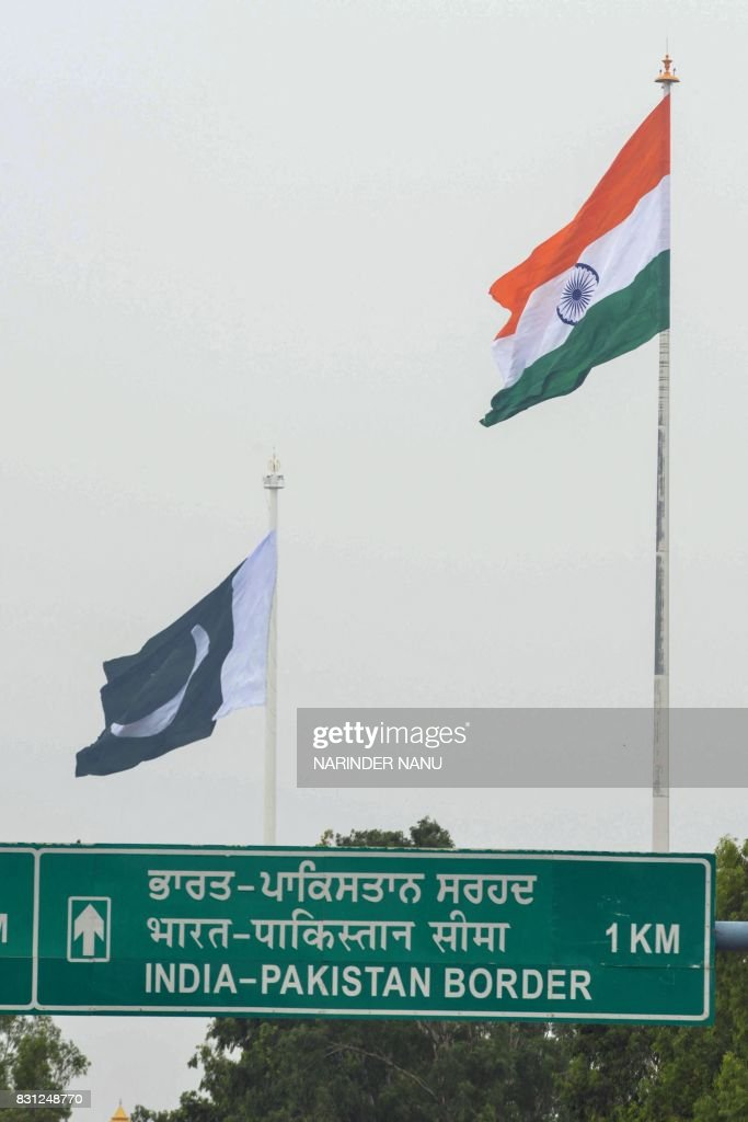 The Pakistani national flag and India`s national flag are seen during a ceremony to celebrate Pakistan`s Independence Day at the IndiaPakistan Wagah..