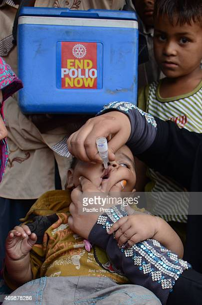 The Pakistani Polio Vaccination Team administers polio drops to gypsy children residents of slum areas during '3 days Antipolio campaign' at a suburb...