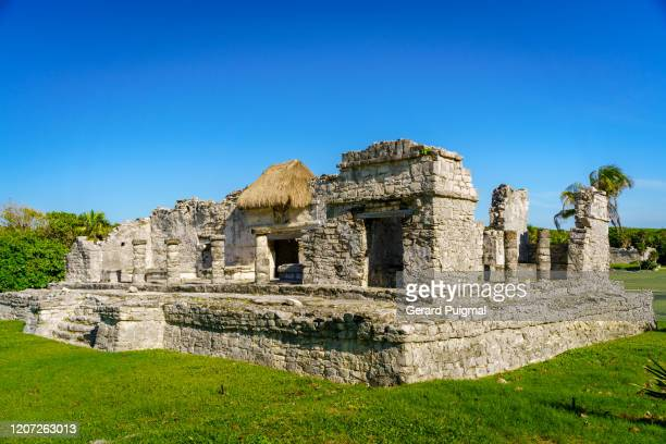 the palace (palacio) at the ruins of tulum, a pre-columbian mayan walled city in yucatán peninsula on the caribbean sea in the state of quintana roo, mexico. - gerard puigmal stock pictures, royalty-free photos & images