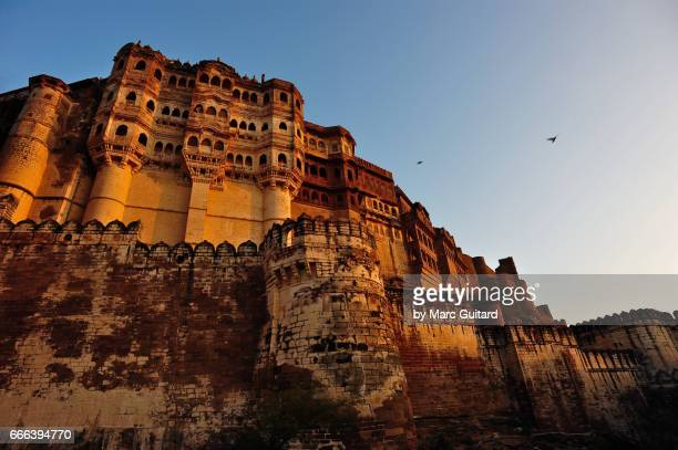 The palace of Mehrengar Fort rises above the massive walls, Jodhpur, Rajasthan, India