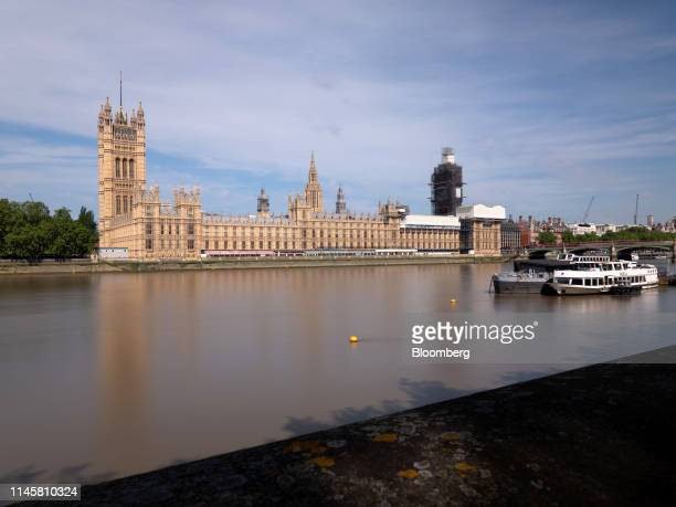 The Palace of Westminster home to the UK Parliament and the House of Lords are viewed from the south bank of the River Thames in London UK on...