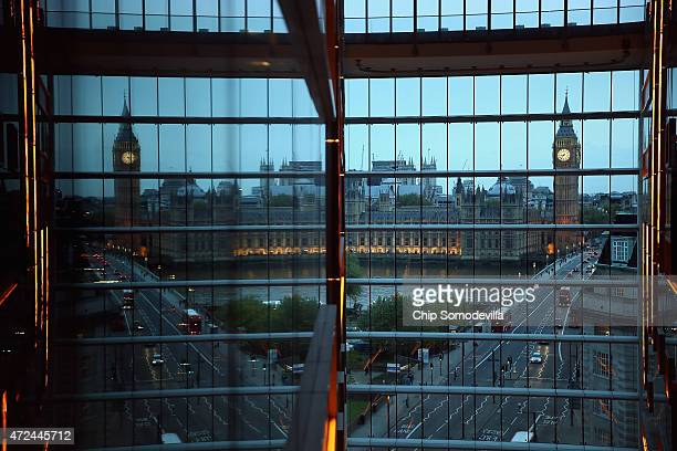 The Palace of Westminster is reflected in a glass wall on May 7 2015 in London England The United Kingdom has gone to the polls to vote for a new...