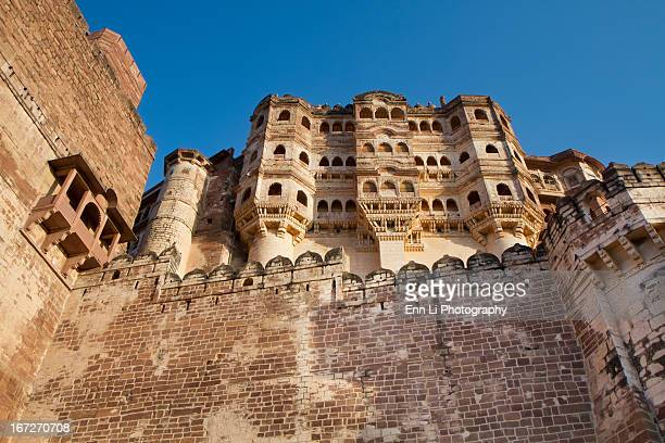 The palace within the fort, rising high above the battlements. Mehrangarh Fort and palace, located in Jodhpur city in Rajasthan state is one of the...