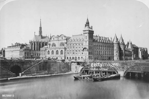 The Palais de Justice or law courts and the Conciergerie prison on the Ile de la Cite in Paris 1856 The Pont au Change is under construction on the...
