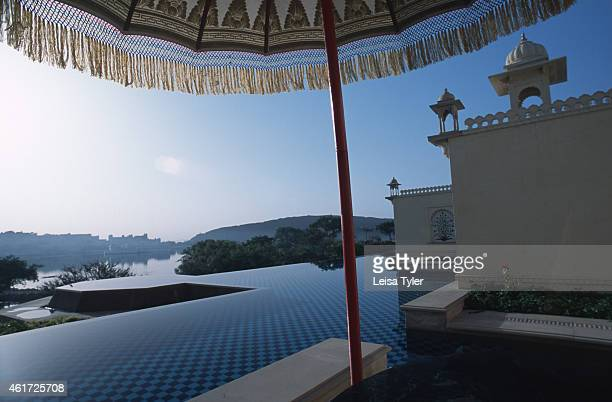 The palatial setting from Udaivilas's lake facing guest rooms A stately sixstar hotel on the far side of Lake Pichola in Udaipur Udaivilas is one of...