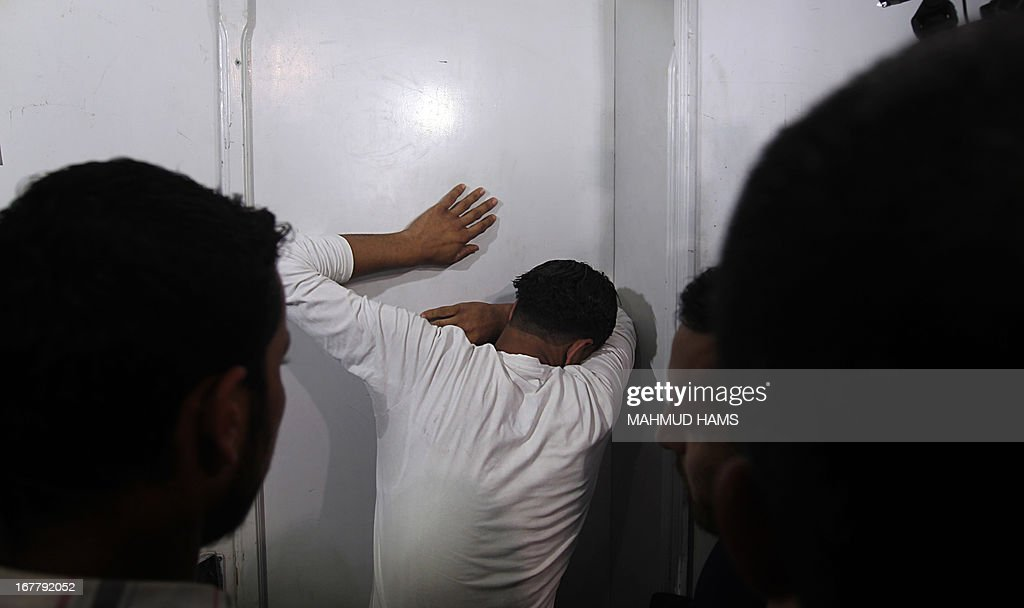 The Palestinian borther of Haitham Al-Meshal, grieves at the Shifa hospital before the funeral in Gaza City, on April 30, 2013. An Israeli air strike on Gaza City killed one person Palestinian officials said, with Israel saying it targeted a militant involved in a rocket attack on Eilat on April 17.