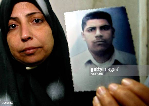 The Palestinian mother of 18yearold Nabil Mas'oud one of two suicide bombers holds his picture March 14 2004 in Jabalya refugee camp in the Gaza...