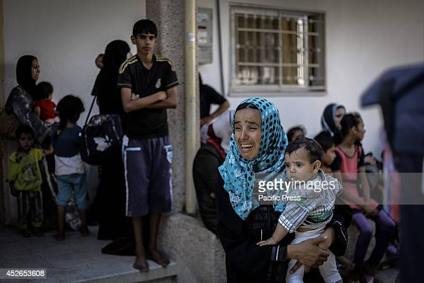 The Palestinians inside the UNrun school sheltering Palestinian refugees from an Israeli air strike in the northern Gaza Strip At least 15 people...