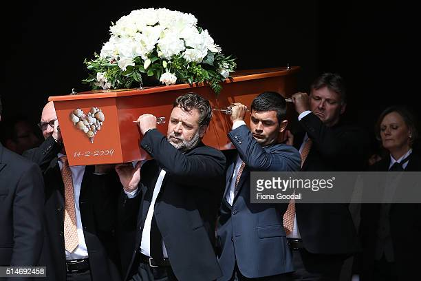 The pall bearers including actor and cousin Russell Crowe carry the casket after the funeral service for Martin Crowe on March 11 2016 in Auckland...