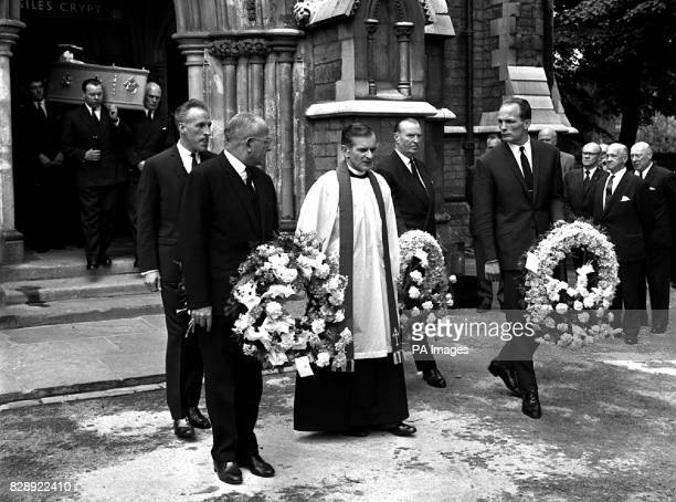 The pallbearers carrying wreaths precede the coffin from StGiles's Church Camberwell London at the funeral of former world boxing champion Freddie...