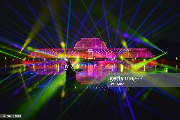 The Palm House at Kew Gardens is illuminated with a light show during a preview for the Christmas at Kew event on November 21 2018 in London England...