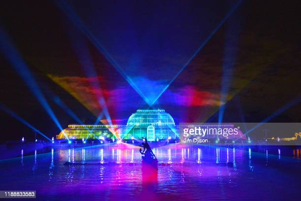 The Palm House at Kew Gardens is illuminated with a light show during a preview for the Christmas at Kew event on November 19 2019 in London England